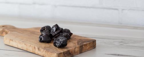 prunes on cutting board