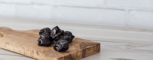 prunes on cutting board