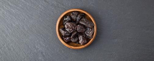brown bowl of prunes