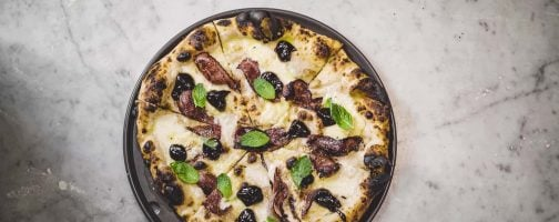 A pizza with prunes